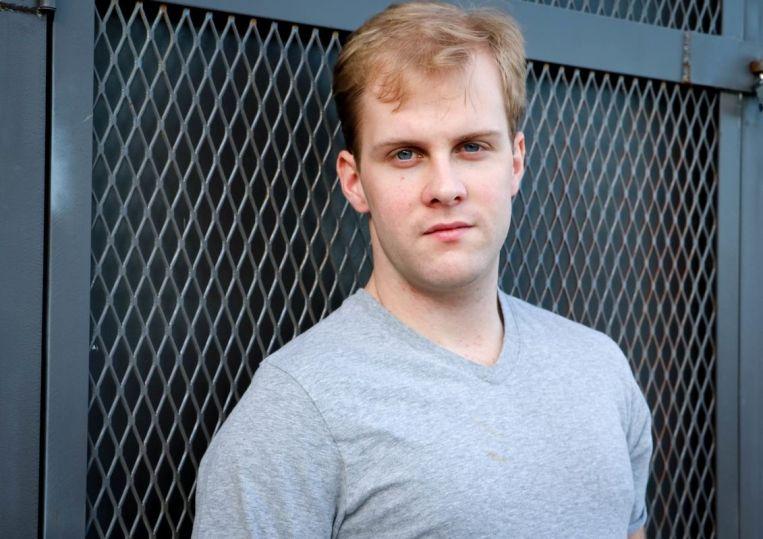 Wyatt wearing grey t-shirt